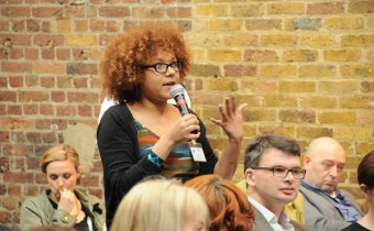 woman with mic at conference